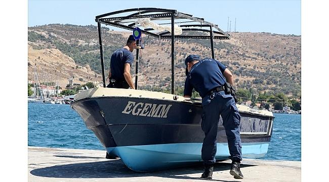 Foça'da batan tekne çıkartıldı